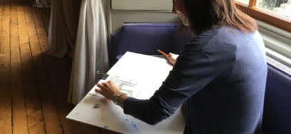a teacher practises drawing