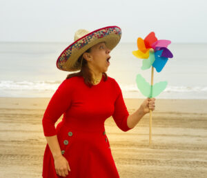 picture shows Helen Woods on the beach playing the character Cherry Pie
